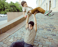 Little son with father in city hagging and smiling Stock Photo