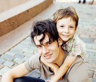 Little son with father in city hagging and smiling, casual look outside playing, happy real family, lifestyle people Royalty Free Stock Images