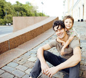 Little son with father in city hagging and smiling, casual look outside playing, happy real family, lifestyle people Stock Photography