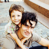 Little son with father in city hagging and smiling, casual look outside playing, happy real family, lifestyle people Stock Image