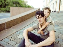 Little son with father in city hagging and smiling Royalty Free Stock Images
