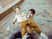 Little son with father in city hagging and smiling Stock Image