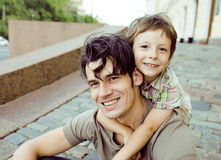 Little son with father in city Stock Photography