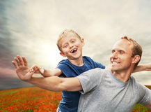 Little son with father on the poppies field Royalty Free Stock Photography