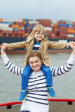 Little son and his mother watching ships on a ferry. Little son and his mother watching ships on a ferry Royalty Free Stock Photo