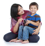 Little son with his pretty  mother. Young little son playing with his pretty young mother in  over white Stock Image