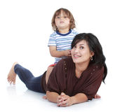 Little son with his pretty mother. Young little son playing with his pretty young mother in over white Stock Images