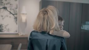 Little son hugs his mom.  stock video footage