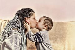 The little son kisses his mother. close up. The little son kisses his mother. Concept: Happy Mother`s Day Royalty Free Stock Photo