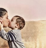 The little son kisses his mother. close up. The little son kisses his mother. Concept: Happy Mother`s Day. close up royalty free stock images