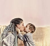 The little son kisses his mother. close up. The little son kisses his mother. Concept: Happy Mother`s Day stock image