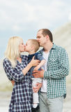 The little son kisses the mother. Family portrait Stock Image