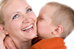 Little son kisses mum. On white Royalty Free Stock Image