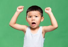 Little son raise up his hand. Little young asian boy portrait stock images