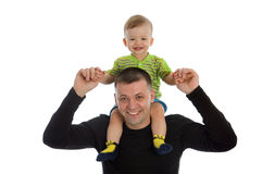 Little son sits on father`s shoulders. Isolated on white royalty free stock images