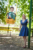 Little son swing with mother at park Royalty Free Stock Photos