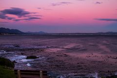 Sunset on Walker bay in Hermanus, South Africa. royalty free stock image