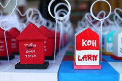 Little souvenirs. The image is paperweight which is designed to postbox . And another is name of island in Thailand. Beside postcard and magnet, paperweight is Royalty Free Stock Photos