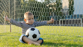 Little sportsman giving a thumbs up Stock Photo
