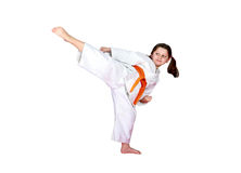 Little sportswoman on a white background beat a high leg kick Royalty Free Stock Photo