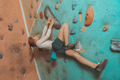 Little sporty girl climbing indoor Stock Images