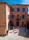 Little square and buildings in Roussillon village in France Royalty Free Stock Photo