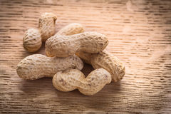 Little stack of peanuts on wooden board food and Royalty Free Stock Image
