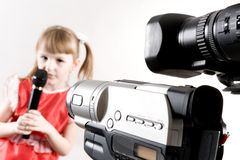 Little star. Some camcorders shooting a singing little girl Royalty Free Stock Photo