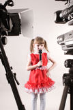Little star. Some camcorders shooting a singing little girl Royalty Free Stock Image