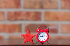 Little star and retro alarm clock Royalty Free Stock Photography