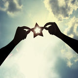 Little star in sky. Holding a star in sky Royalty Free Stock Photo