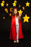 Little stargazer holding big yellow paper star Stock Images