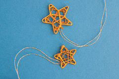 Little stars. Little Christmas golden stars on blue fabric background Stock Photo