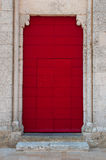 Little step to antique red door Royalty Free Stock Images