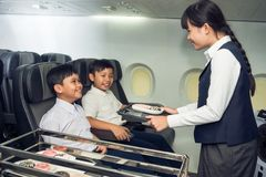Little stewardess and passengers Royalty Free Stock Photos