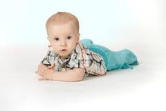 Little stilish boy on the white background. Little stilish six month boy on the white background Royalty Free Stock Photo