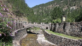 Little stone bridge on mountain stock video footage