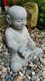 Little Stone Monk (Reading) Royalty Free Stock Images
