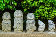Little Stone Monks. Cute stone for gardens decoration Royalty Free Stock Images