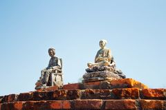 Little stone statues installed on a brick wall in Sukhothai Thailand. Little stone statues installed on a brick wall in Sukhothai historical park in Thailand stock photos