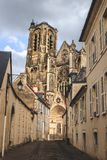 Little street leads to The Cathedral of St Etienne of Bourges, beautiful garden, France. UNESCO World Heritage List stock image