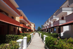 Little street between three-storeyed cottages Stock Photography