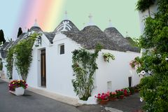 A little street with trulli houses in Alberobello, Puglia, Italy. A fine white housed street in Alberobello, Italy, with trulli Stock Images