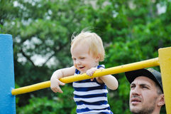 Little strong baby with his father playing sports outdoor. Children during his workout. Royalty Free Stock Photography
