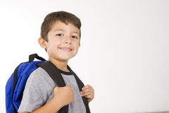 Little student. Little boy with his book bag Royalty Free Stock Images