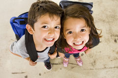 Little student. Little boy and girl with their book bags Stock Photo