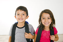 Little student. Little boy and girl with their book bags Stock Photography