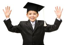 Little student in academic cap. Half-length portrait of little student in academic cap happy gesturing, isolated on white. Concept of graduation and study Stock Image