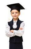 Little student in academic cap with hands crossed Stock Photography