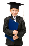 Little student in academic cap keeps folder Royalty Free Stock Photography